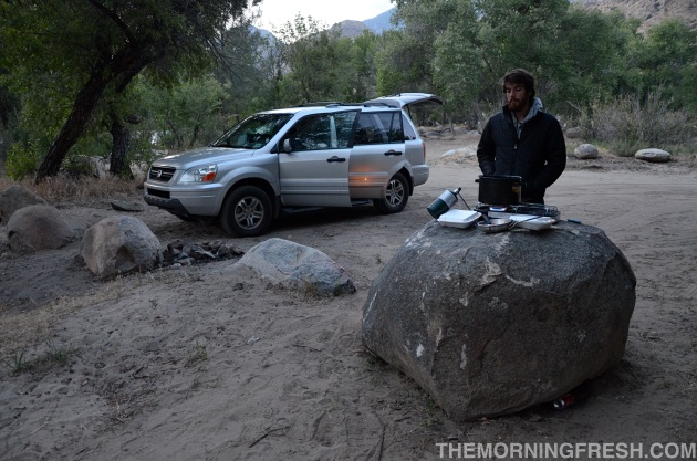 Niko sets up a makeshift kitchen atop a rock during our 2011 car-camping adventure.