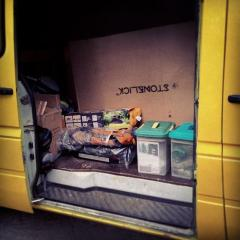 Our van all packed up with climbing gear, camping equipment, and mismatched belongings.
