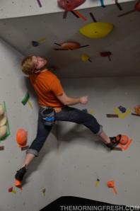 Dakota Lundeen eyes a big dyno move on the new roof wall at Tally Rock Gym during the Save the South event.