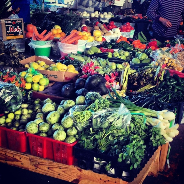 Brightly colored fruits and vegetables at Canino Produce market in Houston, Texas.
