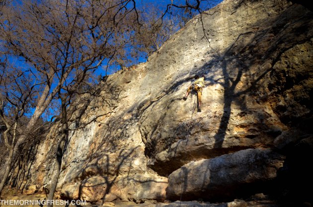 Niko climbing at Reimer's Ranch park in Texas during the Simply Adventure trip.