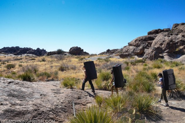 Trekking through the desert landscape at Hueco Tanks State Park during the Simply Adventure trip.