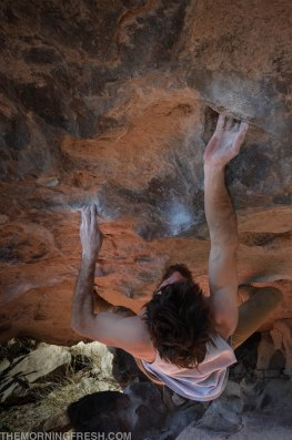 Niko falls into the sweet undercling move on Adjust Your Attitude (V8) at Hueco Tanks State Park.