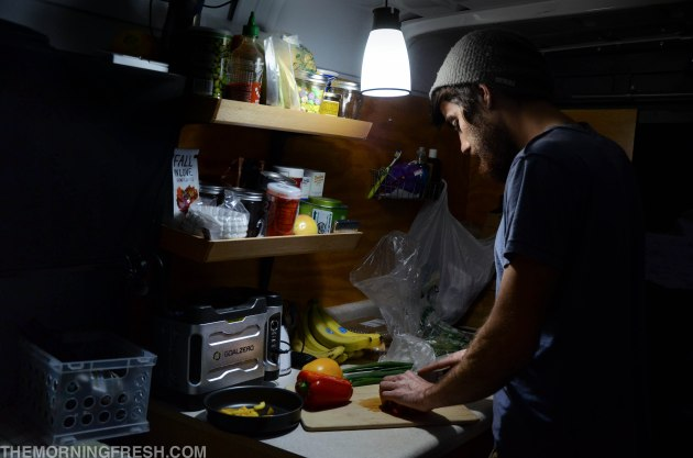 Niko uses the Goal Zero Light-A-Life to illuminate our kitchen space in the van while cooking at night.